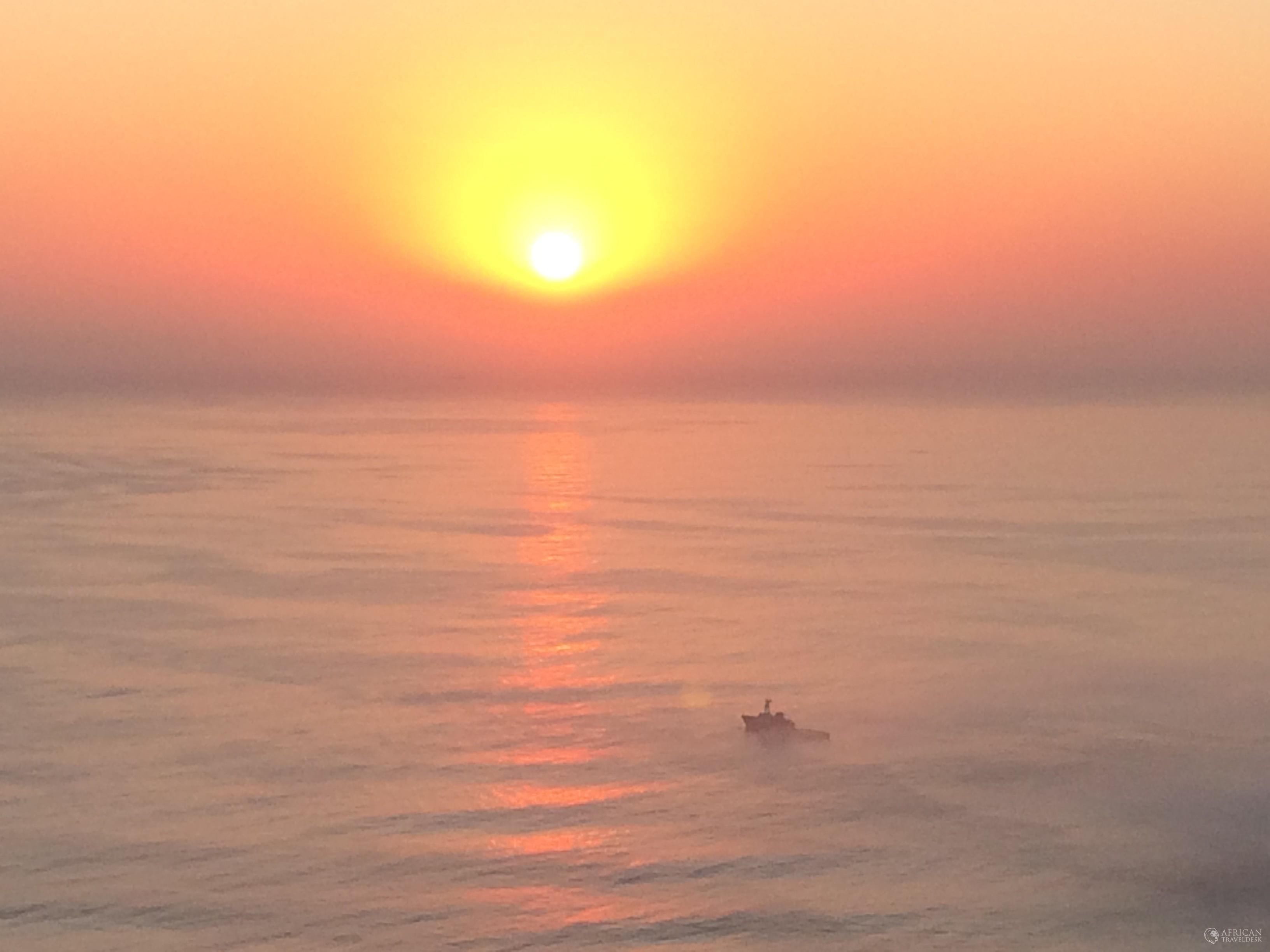 sun-signal-hill-ship-ocean