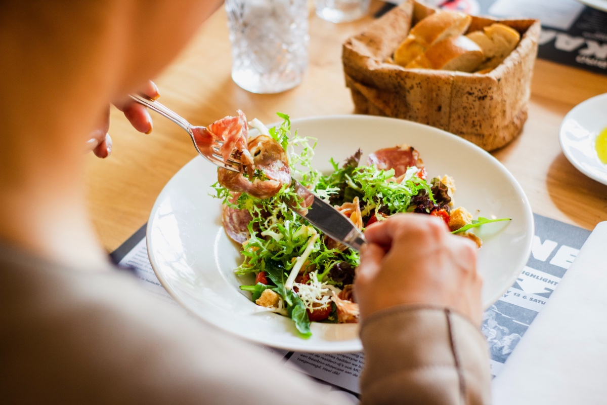 women eating a salad at the restaurant